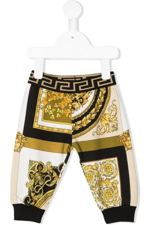 VERSACE Tracksuits - Barocco-print jogger trousers