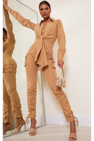 PRETTYLITTLETHING Camel Cargo Plunge Ruched Legs Shirt Jumpsuit
