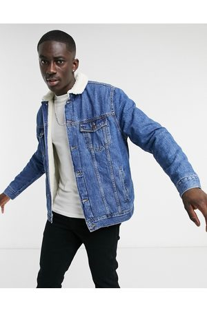 Bershka Denim trucker jacket with teddy collar in