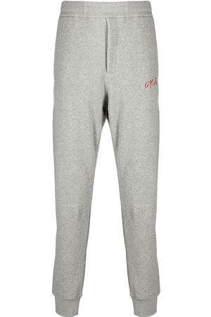 Alexander McQueen Embroidered logo track trousers - Grey