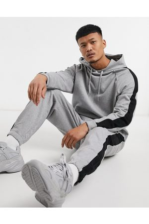 ASOS Oversized tracksuit in heather with colorblock side stripe-Grey