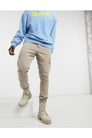 ASOS Tapered washed cargo pants in stone