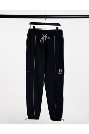 Crooked Tongues Printed sweatpants with reflective piping in