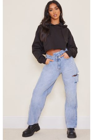 PRETTYLITTLETHING Petite Light Wash Baggy Low Rise Asymmetric Waistband Thigh Split Boyfriend Jeans