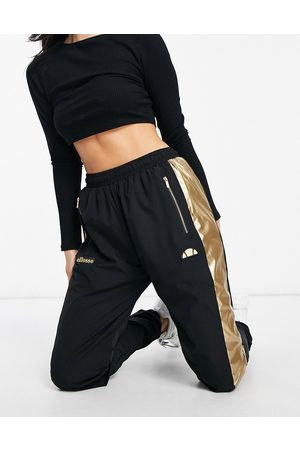 Ellesse Track pants in and gold- exclusive to ASOS
