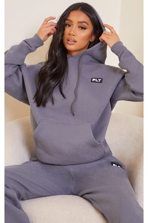 PRETTYLITTLETHING Petite Charcoal Badge Detail Oversized Hoodie