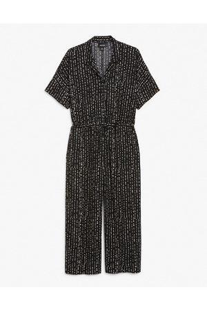 Monki Kalolo short sleeve jumpsuit in black and