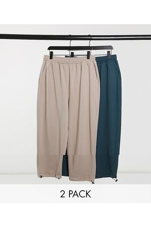 ASOS Super oversized sweatpants with toggle hem in beige and teal 2-pack-Multi