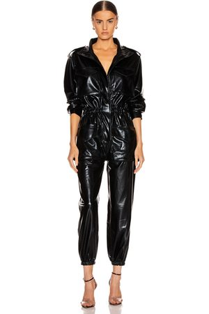 Norma Kamali Turtleneck Cargo Jumpsuit in