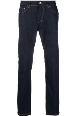 Dolce & Gabbana DG embossed slim fit jeans