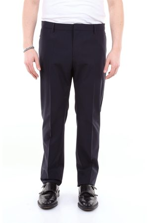 VALENTINO Solid color trousers with contrasting logo