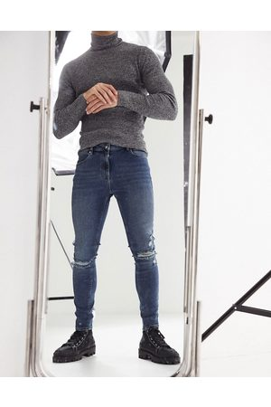 ASOS Spray on 'vintage look' jeans with power stretch in dark tint with knee rips-Blues