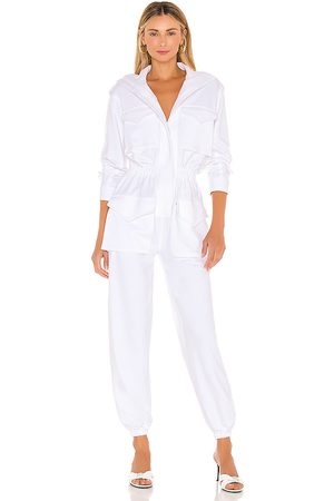 Norma Kamali Turtle Cargo Jumpsuit in White.