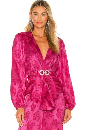 RONNY KOBO Justine Belted Top in Fuchsia.