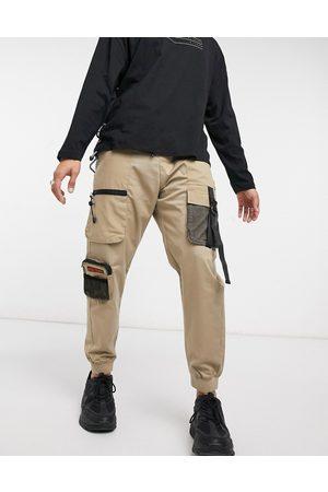 Bershka Cargo sweatpants with mesh detail in -Neutral
