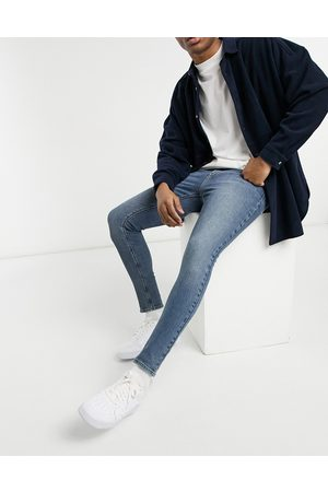 ASOS Vintage look spray on jeans with power stretch in mid blue-Blues