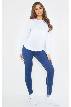 PRETTYLITTLETHING Maternity Mid Wash Pull On Skinny Jeans