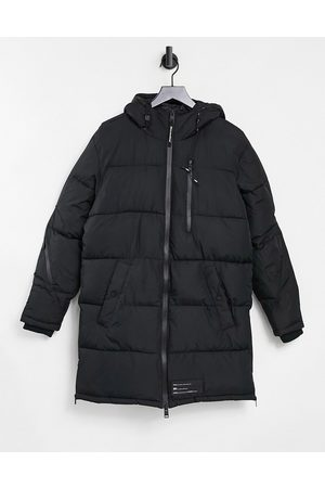 Bershka Longline padded puffer jacket in black-Grey
