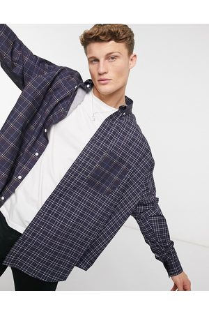 ASOS Oversize wide spliced patchwork plaid shirt in Navy
