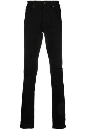AMIRI Men Skinny - Distressed skinny-cut jeans