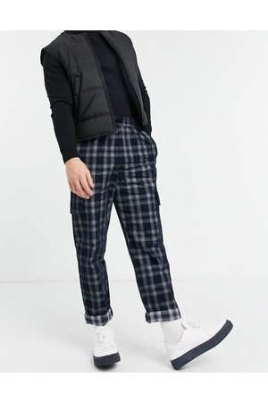 ASOS Skater fit pants in brushed plaid with cargo pockets