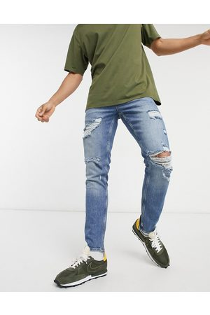 ASOS Stretch slim jeans in vintage mid wash blue with heavy rips-Blues