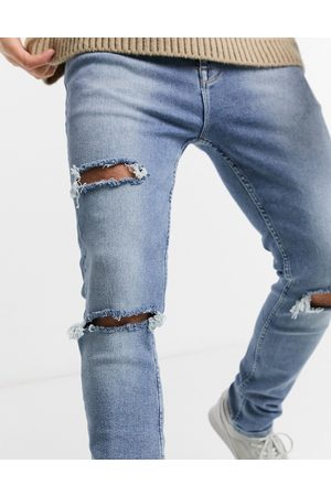 ASOS Extra stretch skinny jeans in vintage light wash with heavy rips-Blues