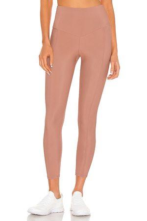 Onzie Sweetheart Midi Legging in Pink.