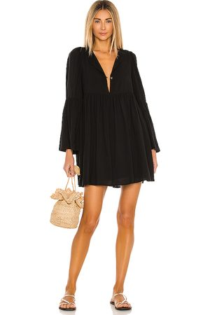 Indah Minta Solid Seamless Babydoll Mini Dress in .