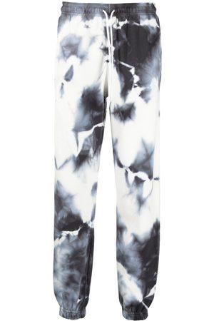 MARCELO BURLON Tie-dye print track pants