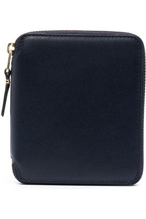 Comme des Garçons Leather zip wallet