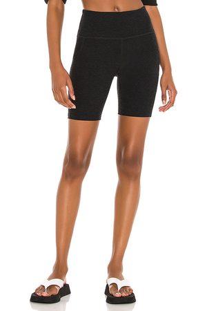 Beyond Yoga Spacedye Team Pockets High Waisted Bike Short in Black.