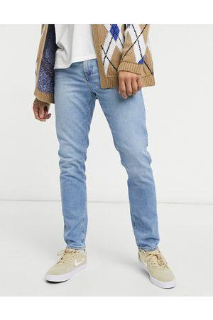 ASOS DESIGN Stretch slim jeans in light wash blue-Blues