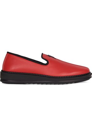 Giuseppe Zanotti Slip-on leather slippers with logo detail
