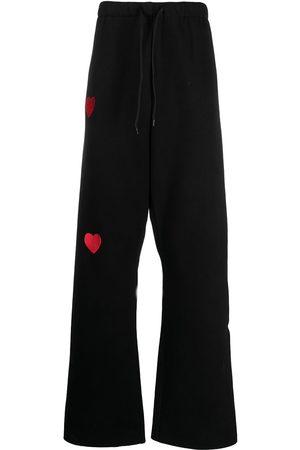 Natasha Zinko Women Wide Leg Pants - Heart-embroidered wide-leg trousers