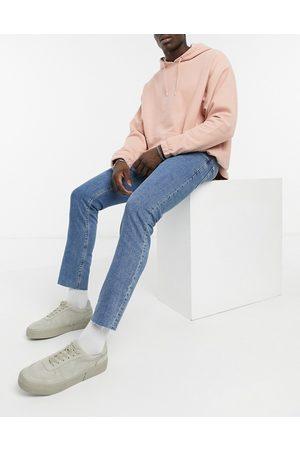ASOS Stretch slim jeans in flat mid blue with raw hem-Blues