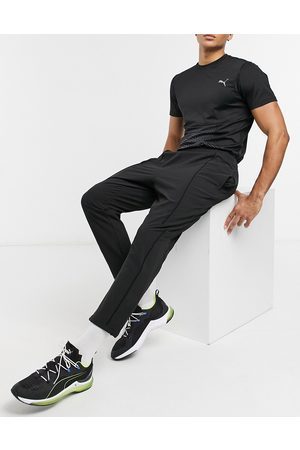 PUMA Pants - Training first Mile texture woven track pants in