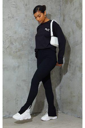 PRETTYLITTLETHING Textured Ribbed Split Hem Leggings