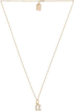 MIRANDA FRYE Gothic Charm & Van Chain Necklace in Metallic .
