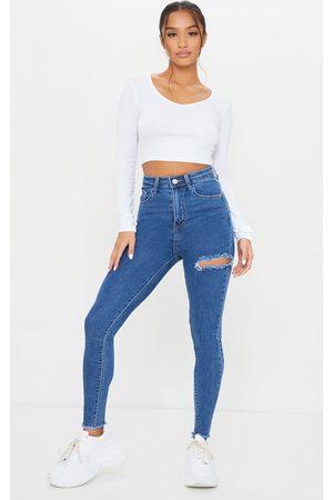 PRETTYLITTLETHING Petite Mid Thigh Rip Raw Hem 5 Pocket Skinny Jeans
