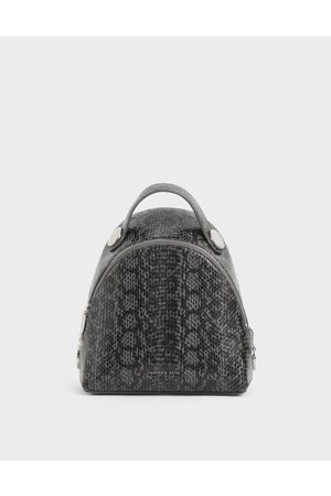 CHARLES & KEITH Snake Print Dome Backpack