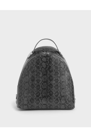 CHARLES & KEITH Large Snake Print Dome Backpack