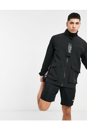 PUMA Jackets - Training First Mile texture woven track jacket in