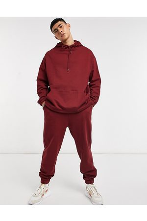 ASOS Organic tracksuit with oversized hoodie & oversized sweatpants in burgundy