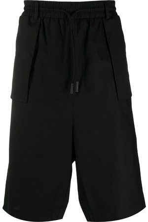 MARCELO BURLON Men Shorts - Knee-length track shorts