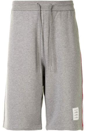 Thom Browne Men Sports Shorts - Signature Stripe track shorts - Grey