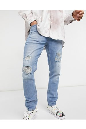 ASOS Stretch slim jeans in vintage mid wash with heavy rips-Blues