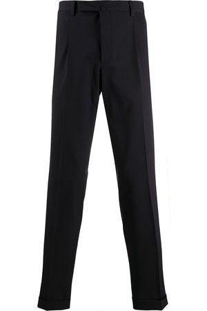 BRIGLIA Tailored cut creased trousers