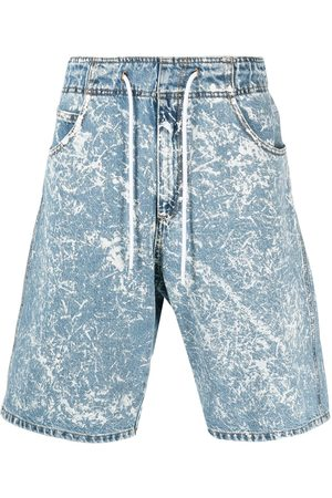 Msgm Acid wash denim shorts