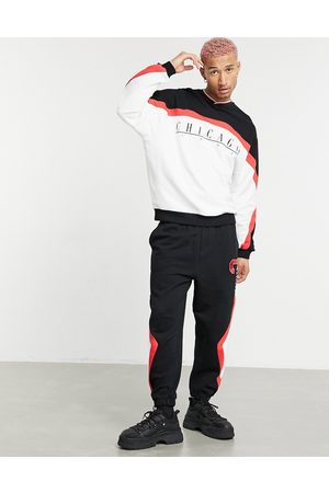ASOS Coordinating oversized sweatpants with color block 'Chicago' print in vintage wash